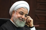 FILE - In this Sept. 16, 2019, file photo, Iranian President Hassan Rouhani attends a joint news conference in Ankara, Turkey. Rouhani reiterated Tuesday, Sept. 24, that he would not consider meeting with President Donald Trump unless sanctions imposed against his country since 2018 were first lifted. (AP Photo/Pavel Golovkin, Pool, File)