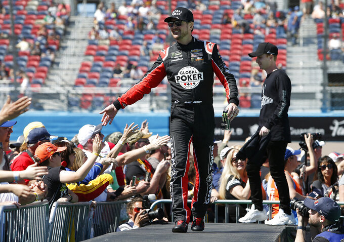 Kurt Busch is greeted by fans during driver introductions prior to the start of the NASCAR Cup Series auto race at ISM Raceway, Sunday, March 10, 2019, in Avondale, Ariz. (AP Photo/Ralph Freso)