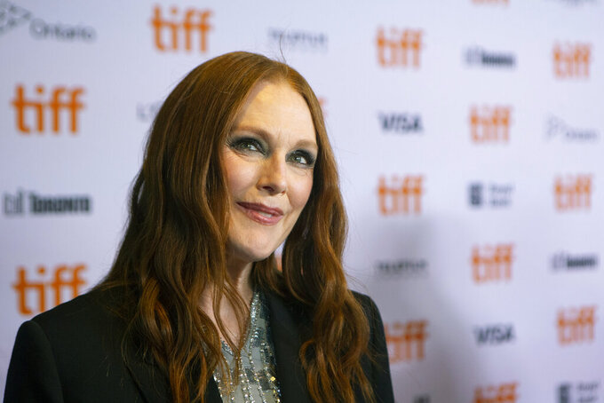 """Julianne Moore walks the red carpet as she promotes the film """"Dear Evan Hansen"""" in Toronto during the Toronto International Film Festival on Thursday, Sept. 9, 2021. (Chris Young/The Canadian Press via AP)"""