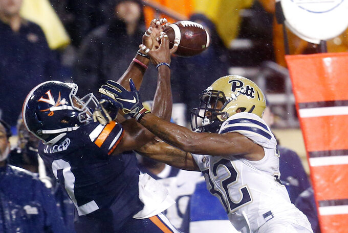 Virginia wide receiver Joe Reed (2) reaches for a pass as Pittsburgh defensive back Phillipie Motley (32) breaks it up during the first half of an NCAA college football game in Charlottesville, Va., Friday, Nov. 2, 2018. (AP Photo/Steve Helber)
