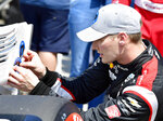 Indycar driver Josef Newgarden places his pole-winning sticker on his car after capturing the top qualifying position during the final practice session for the Grand Prix of Long Beach auto race Saturday, Sept. 25, 2021, in Long Beach, Calif. (Will Lester/The Orange County Register via AP)