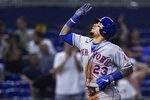New York Mets' Javier Baez celebrates his home run during the third inning of the team's baseball game against the Miami Marlins, Thursday, Sept. 9, 2021, in Miami. (AP Photo/Wilfredo Lee)