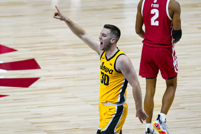 Iowa guard Connor McCaffery (30) celebrates in the closing minute against Wisconsin in an NCAA college basketball game at the Big Ten Conference men's tournament in Indianapolis, Friday, March 12, 2021. Iowa won 62-57. (AP Photo/Michael Conroy)