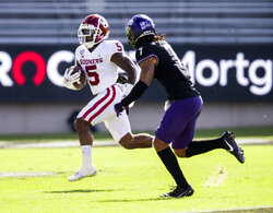 Oklahoma running back T.J. Pledger (5) carries the ball as TCU safety Trevon Moehrig (7) defends during the first half of an NCAA college football game, Saturday, Oct. 24, 2020, in Fort Worth, Texas. (AP Photo/Brandon Wade)