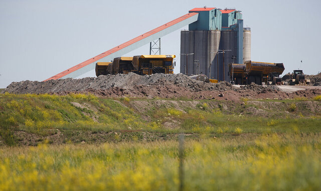 FILE - This Tuesday, July 2, 2019 file photo shows Eagle Butte mine in in Gillette, Wyo., following the closure of the Blackjewel mines.The coal industry was already hurting before the coronavirus. The pandemic has made things a lot worse. Production is down along with electricity demand, with office and school lights off across the nation.  (Josh Galemore/The Casper Star-Tribune via AP, File)