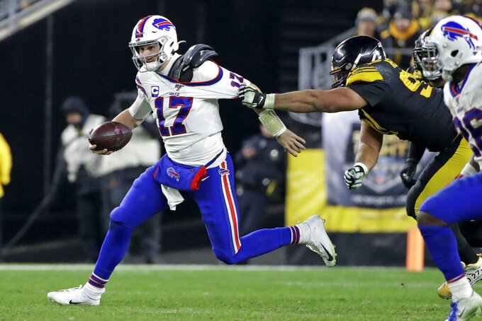 Buffalo Bills quarterback Josh Allen (17) is tackled by Pittsburgh Steelers defensive end Cameron Heyward (97) during the second half of an NFL football game in Pittsburgh, Sunday, Dec. 15, 2019. (AP Photo/Don Wright)