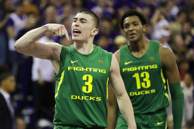 Oregon guard Payton Pritchard (3), reacts with forward Chandler Lawson (13) after Pritchard made the game-winning 3-point basket in overtime of an NCAA college basketball game against Washington, Saturday, Jan. 18, 2020, in Seattle. Oregon won 64-61 in overtime. (AP Photo/Ted S. Warren)