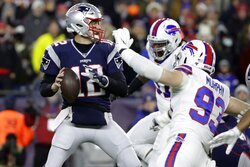 New England Patriots quarterback Tom Brady, left, passes under pressure from Buffalo Bills defensive end Trent Murphy (93) in the first half of an NFL football game, Saturday, Dec. 21, 2019, in Foxborough, Mass. (AP Photo/Elise Amendola)