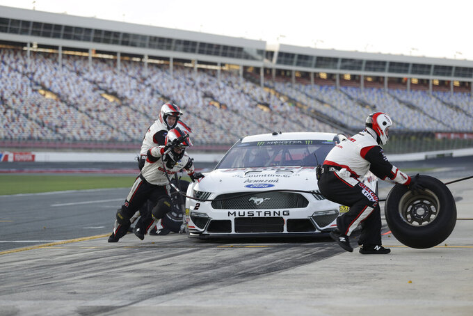 Crew members perform a pit stop on driver Brad Keselowski's car during qualifying for Saturday's NASCAR All-Star Cup series auto race at Charlotte Motor Speedway in Concord, N.C., Friday, May 17, 2019. (AP Photo/Chuck Burton)