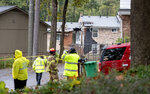 Authorities investigate the scene where an airplane crashed into an apartment complex, Wednesday, Oct. 30, 2019, in Atlanta. (AP Photo/David Goldman)