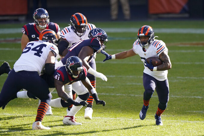 Chicago Bears' David Montgomery (32) runs for a touchdown during the first half of an NFL football game against the Houston Texans, Sunday, Dec. 13, 2020, in Chicago. (AP Photo/Nam Y. Huh)