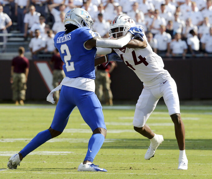 Middle Tennessee wide receiver Izaiah Gathings (2) and Virginia Tech defensive back Dorian Strong (44) battle in the second half of an NCAA college football game, Saturday, Sept. 11, 2021, in Blacksburg Va. (AP Photo/Matt Gentry)