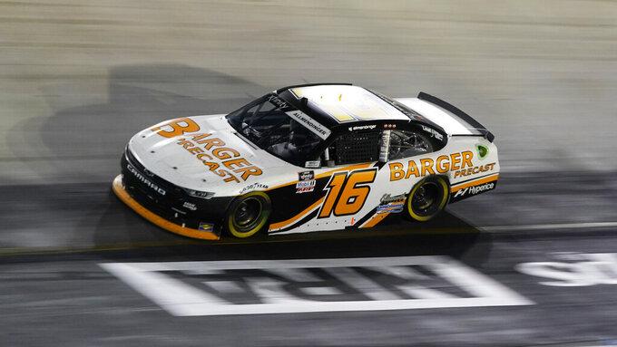 AJ Allmendinger drives through a turn during a NASCAR Xfinity Series auto race at Bristol Motor Speedway Friday, Sept. 17, 2021, in Bristol, Tenn. (AP Photo/Mark Humphrey)