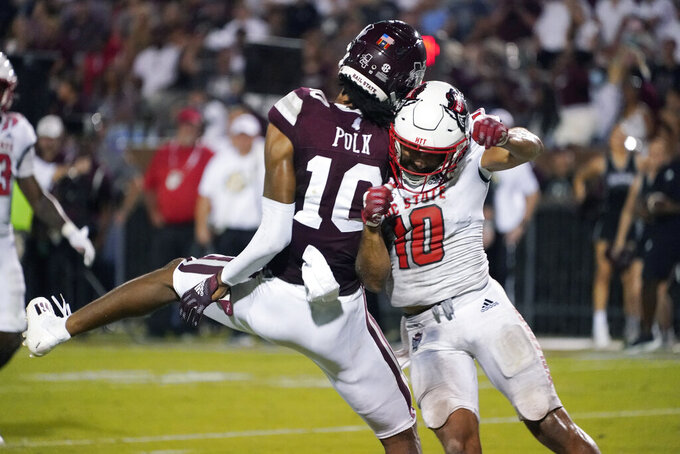 Mississippi State wide receiver Makai Polk (10) and North Carolina State safety Tanner Ingle (10) collide on an incomplete pass during the second half of an NCAA college football game in Starkville, Miss., Saturday, Sept. 11, 2021. (AP Photo/Rogelio V. Solis)