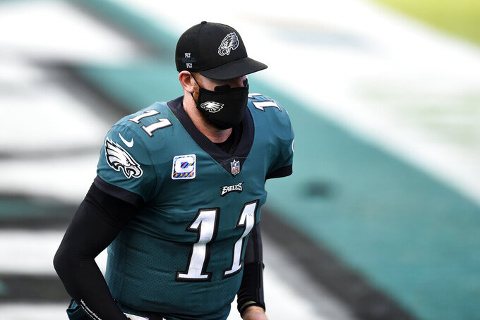 Philadelphia Eagles' Carson Wentz walks off the field after an NFL football game against the Baltimore Ravens, Sunday, Oct. 18, 2020, in Philadelphia. (AP Photo/Derik Hamilton)
