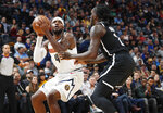 Denver Nuggets forward Paul Millsap, left, is defended by Brooklyn Nets forward Taurean Prince during the first half of an NBA basketball game Thursday, Nov. 14, 2019 in Denver. (AP Photo/David Zalubowski)
