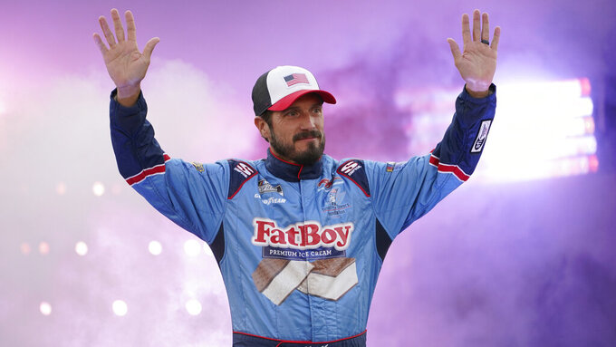 JJ Yeley waves to the crowd during driver introductions prior to the start of the NASCAR Cup series auto race in Richmond, Va., Saturday, Sept. 11, 2021. (AP Photo/Steve Helber)