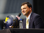 FILE - This Tuesday July 16, 2019, file photo shows West Virginia head coach Neal Brown speaking during Big 12 Conference NCAA college football media day at AT&T Stadium in Arlington, Texas. (AP Photo/David Kent)