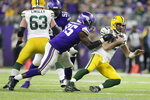 Green Bay Packers quarterback Aaron Rodgers is sacked by Minnesota Vikings defensive end Ifeadi Odenigbo (95) during the second half of an NFL football game Monday, Dec. 23, 2019, in Minneapolis. (AP Photo/Andy Clayton-King)