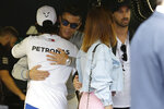 Mercedes driver Lewis Hamilton of Britain, left, welcomes Cristiano Ronaldo at the pit line ahead of the second practice session at the Monaco racetrack, in Monaco, Thursday, May 23, 2019. The Formula one race will be held on Sunday. (AP Photo/Luca Bruno)