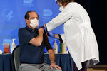 Health and Human Services Secretary Alex Azar receives his first dose of the COVID-19 vaccine at the National Institutes of Health, Tuesday, Dec. 22, 2020, in Bethesda, Md. (AP Photo/Patrick Semansky, Pool)