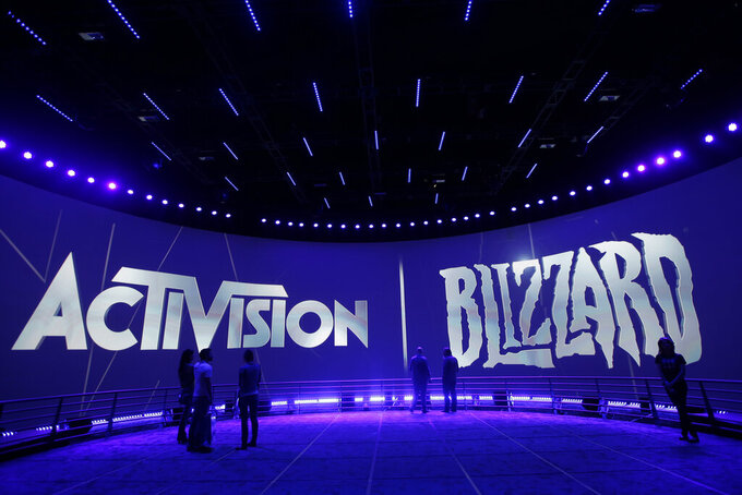 """FILE - This June 13, 2013 file photo shows the Activision Blizzard Booth during the Electronic Entertainment Expo in Los Angeles. Activision Blizzard, one of the world's most high-profile video game companies, confirmed an SEC probe and said it is working to address complaints of workplace discrimination. The Santa Monica, California, company said Tuesday, Sept. 21, 2021,  that it is complying with a recent Securities and Exchange Commission subpoena sent to current and former employees and executives and the company itself on """"employment matters and related issues.""""  (AP Photo/Jae C. Hong, File)"""