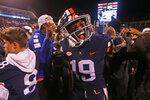 Virginia wide receiver Chuck Davis (19) celebrates his team's win over Miami after an NCAA college football game in Charlottesville, Va., Saturday, Oct. 13, 2018. Virginia defeated Miami 16-13. (AP Photo/Steve Helber)