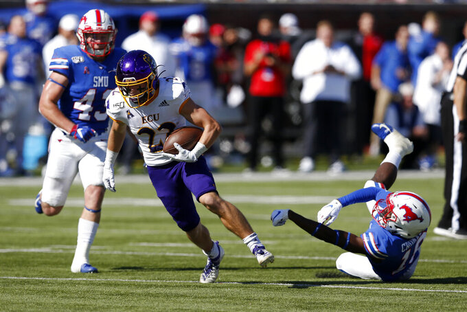 East Carolina receiver Tyler Snead (22) advances the ball after SMU safety Chace Cromartie, right, misses a tackle during the second half of an NCAA college football game, Saturday, Nov. 9, 2019, in Dallas. (AP Photo/Roger Steinman)
