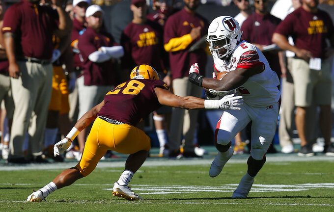 Utah running back Zack Moss (2) avoids a tackle by Arizona State defensive back Demonte King in the first half during an NCAA college football game, Saturday, Nov. 3, 2018, in Tempe, Ariz. (AP Photo/Rick Scuteri)