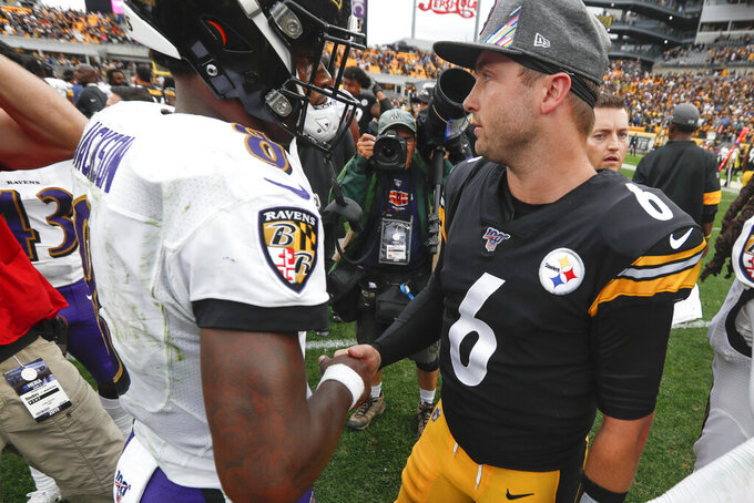 Pittsburgh Steelers quarterback Devlin Hodges (6) and Baltimore Ravens quarterback Lamar Jackson (8) meet after overtime of an NFL football game, Sunday, Oct. 6, 2019, in Pittsburgh. The Ravens won 26-23. (AP Photo/Don Wright)