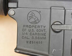 This evidence photo from the criminal complaint of the U.S. District Court for Massachusetts v. Ashley Bigsbee for illegal possession of a machine gun on Nov. 15, 2015, in Suffolk, Mass., shows a detail from one of the six automatic M4 assault rifles that former Army Reserve member James Morales stole from the Lincoln Stoddard Army Reserve Center in Worcester, Mass. (U.S. District Court for Massachusetts via AP)