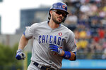 Chicago Cubs' Kris Bryant rounds third after hitting a solo home run off Pittsburgh Pirates starting pitcher Jordan Lyles during the first inning of a baseball game in Pittsburgh, Thursday, July 4, 2019. (AP Photo/Gene J. Puskar)