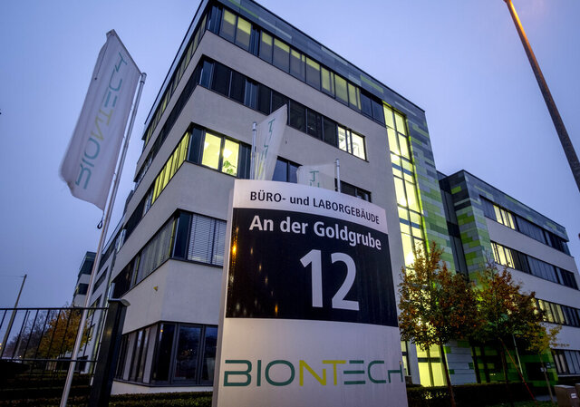 File -- In this Tuesday, Nov.10, 2020 file photo windows are illuminated at the headquarters of the German biotechnology company BioNTech in Mainz, Germany. Pfizer and BioNTech say they've won permission Wednesday, Dec. 2, 2020, for emergency use of their COVID-19 vaccine in Britain, the world's first coronavirus shot that's backed by rigorous science -- and a major step toward eventually ending the pandemic.(AP Photo/Michael Probst, file)