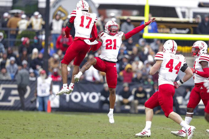 Nebraska cornerback Lamar Jackson (21) celebrates an interception with cornerback Braxton Clark (17) during the first half of an NCAA college football game against Purdue in West Lafayette, Ind., Saturday, Nov. 2, 2019. (AP Photo/Michael Conroy)