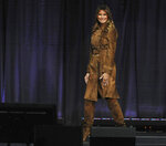 First lady Melania Trump walks off the stage after speaking at the B'More Youth Summit, Tuesday, Nov. 26, 2019, at UMBC in Baltimore. The first lady urged students to avoid misusing drugs, saying that it would make it harder for them to achieve. (Barbara Haddock Taylor/The Baltimore Sun via AP)