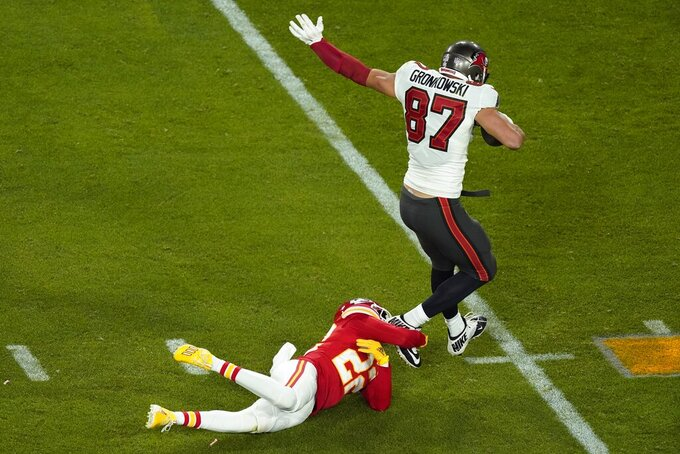 Tampa Bay Buccaneers' Rob Gronkowski (87) is stopped by Kansas City Chiefs' Juan Thornhill (22) during the second half of the NFL Super Bowl 55 football game Sunday, Feb. 7, 2021, in Tampa, Fla. (AP Photo/Charlie Riedel)