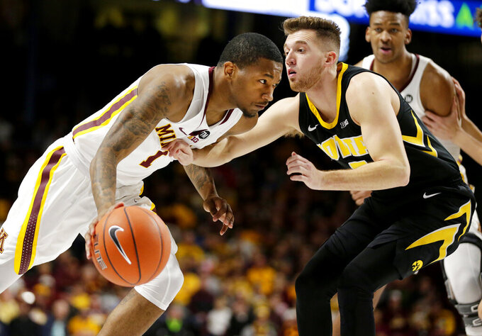 Minnesota guard Dupree McBrayer (1) drives on Iowa guard Jordan Bohannon (3) during the first half of an NCAA college basketball game Sunday, Jan. 27, 2019, in Minneapolis. (AP Photo/Andy Clayton-King)