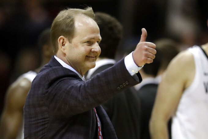 Mississippi head coach Kermit Davis gestures to the fans as he leaves the court after his team defeated Vanderbilt in an NCAA college basketball game Saturday, Jan. 5, 2019, in Nashville, Tenn. (AP Photo/Mark Humphrey)