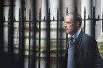 FILE - In this file photo dated Wednesday, March 11, 2020, British lawmaker Foreign Secretary Dominic Raab, walks towards 10 Downing Street for a Cabinet meeting in London.  With British Prime Minister Boris Johnson hospitalized and in intensive care Wednesday April 8, 2020, after contracting the new coronavirus, Raab is among key players in Johnson's Cabinet who will be directing Britain's response to the highly contagious COVID-19 coronavirus, while their leader is being treated. (AP Photo/Frank Augstrin, FILE)