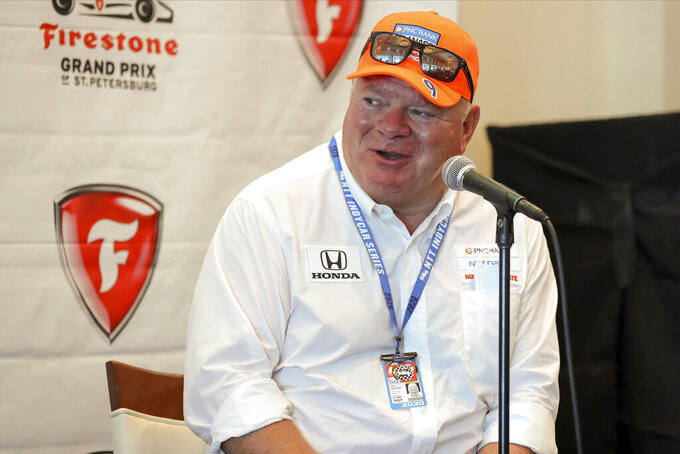 """FILE - Chip Ganassi speaks about driver Jimmie Johnson joining his IndyCar team for next season at a press conference during the IndyCar race weekend in St. Petersburg, Fla., in this Saturday, Oct. 24, 2020, file photo. Chip Ganassi has sold his NASCAR team to Justin Marks, owner of Trackhouse Racing, and will pull out of the nation's top stock car series at the end of this season. Ganassi fields two cars in the Cup Series but will transfer his North Carolina race shop and all its assets to Marks for 2022. """"He made me a great offer that required my attention,"""" Ganassi told The Associated Press on Wednesday, June 30, 3031, as the sale was announced. (AP Photo/Mike Carlson, File)"""