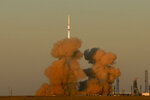 In this photo provided by Roscosmos Space Agency Press Service, a Proton-M booster rocket carrying the Nauka module blasts off from the launch pad at Russia's space facility in Baikonur, Kazakhstan, Wednesday, July 21, 2021. Russia has successfully launched a long-delayed lab module for the International Space Station. The module is intended to provide more room for scientific experiments and space for the crew. (Roscosmos Space Agency Press Service photo via AP)