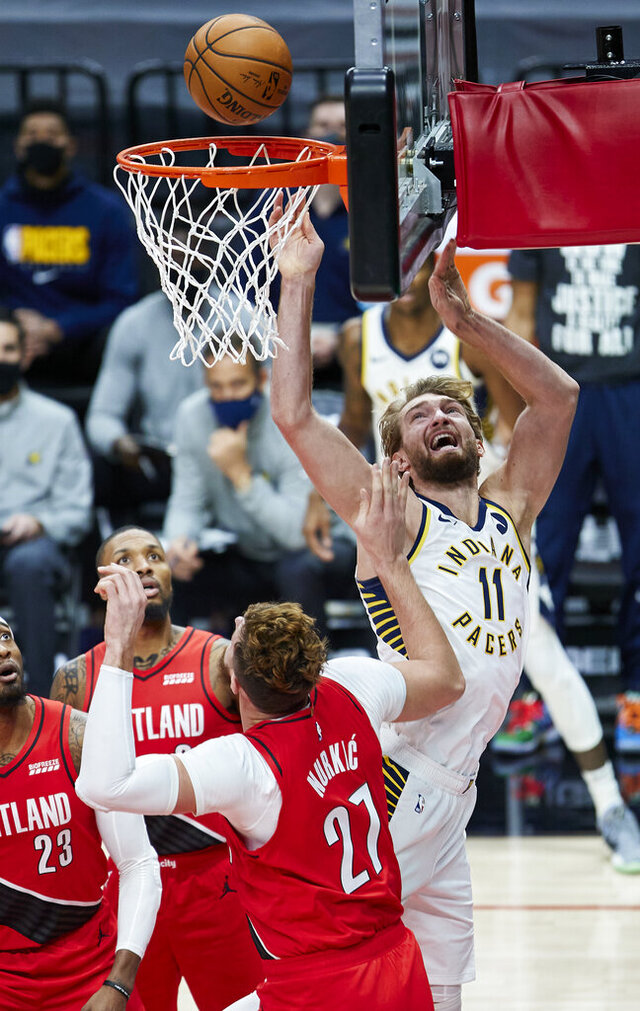 Indiana Pacers forward Domantas Sabonis, right, shoots over Portland Trail Blazers center Jusuf Nurkic during the first half of an NBA basketball game in Portland, Ore., Thursday, Jan. 14, 2021. (AP Photo/Craig Mitchelldyer)
