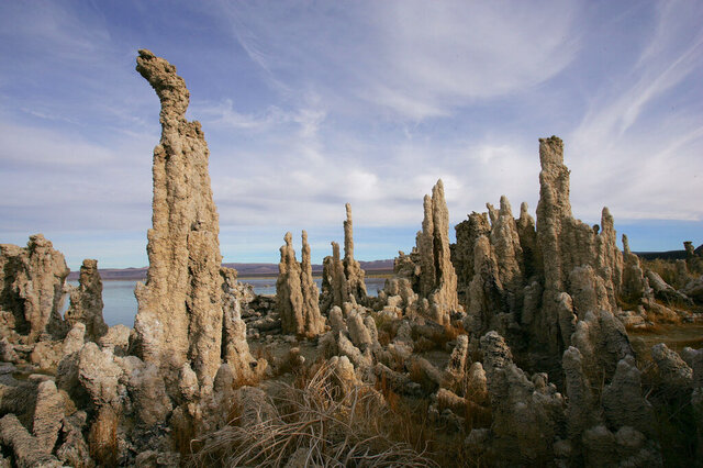 FILE - In this Nov. 15, 2004 file photo Mono Lake tufa towers are seen near Lee Vining, Calif. Thousands of California gulls that return each year to Mono Lake in the eastern Sierra Nevada are increasingly finding their nesting grounds crowded out by an invasive bush species. The 11,075 nests counted this year on the lake's islets were the fewest recorded over 34 years of study, the Los Angeles Times reported this week. (AP Photo/Ben Margot,File)