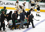 Dallas Stars defenseman Roman Polak (45) is taken off the ice on a stretcher after going head-first into the boards during the second period of the team's NHL hockey game against the Boston Bruins, Thursday, Oct. 3, 2019, in Dallas. (AP Photo/Brandon Wade)