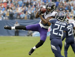 FILE - In this Oct. 14, 2018, file photo, Baltimore Ravens wide receiver John Brown catches a pass as Tennessee Titans' Adoree' Jackson (25) defends in the first half of an NFL football game in Nashville, Tenn. The Buffalo Bills continued their major foray into free agency on Tuesday, March 12, 2019, by agreeing to sign receivers John Brown and Cole Beasley and hulking offensive lineman Ty Nsekhe. (AP Photo/James Kenney, File)