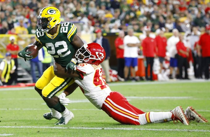 Green Bay Packers' Dexter Williams gets past Kansas City Chiefs' Raymond Davison for a touchdown run during the second half of a preseason NFL football game Thursday, Aug. 29, 2019, in Green Bay, Wis. (AP Photo/Mike Roemer)