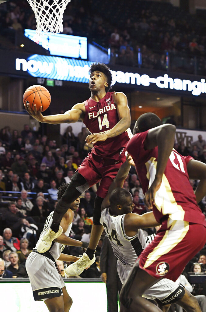 Florida State's Terance Mann (14) drives to the basket over Wake Forest's Sunday Okeke (34) during the second half of an NCAA college basketball game on Saturday, March 9, 2019 in Winston-Salem, N.C. Florida State beat Wake Forest 65 to 57. (AP Photo/Woody Marshall)