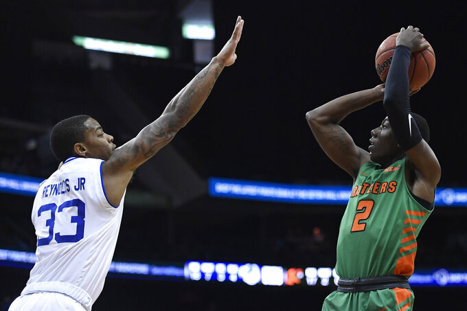 Florida A&M guard Kamron Reaves (2) shoots over Seton Hall guard Shavar Reynolds (33) during the first half of an NCAA college basketball game, Saturday, Nov. 23, 2019, in Newark, N.J. (AP Photo/Sarah Stier)