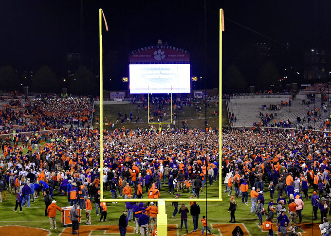 Clemson fans rush the field after the team's NCAA college football game against Duke on Saturday, Nov. 17, 2018, in Clemson, S.C. Clemson won 35-6. (AP Photo/Richard Shiro)