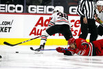 Carolina Hurricanes' Jesper Fast (71) collides with Chicago Blackhawks' Brandon Hagel (38) and loses control of the puck during the first period of an NHL hockey game in Raleigh, N.C., Tuesday, May 4, 2021. (AP Photo/Karl B DeBlaker)